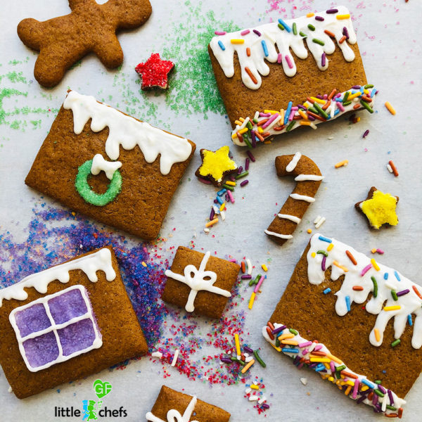 decorated gingerbread houses pieces before assembly