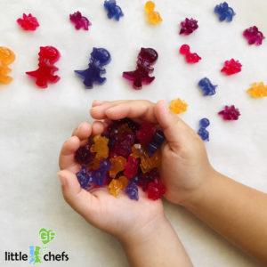 child holding handful of allergy friendly gummy bears