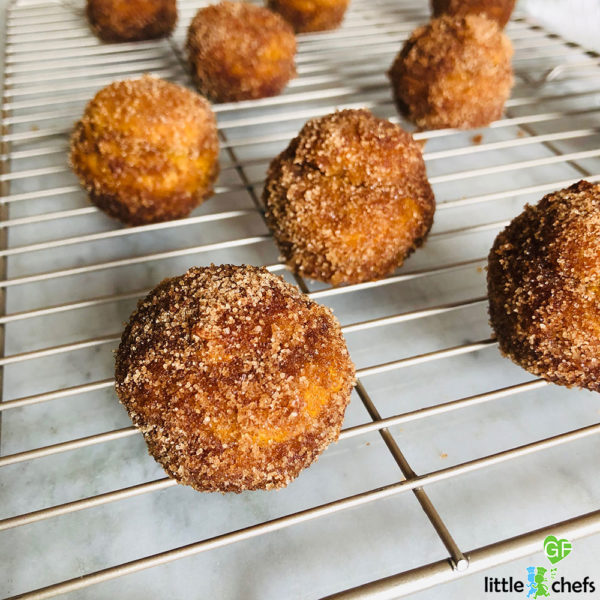 gluten free donut holes on cooling rack