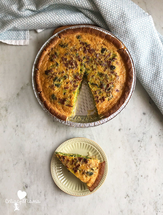 slice of vegetable bacon quiche and remaining pie shell